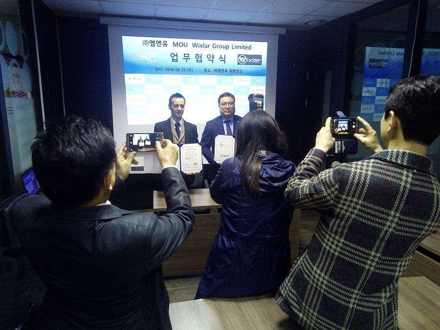 Wixlar Cryptocurrency CEO assigning Mutual Agreement with MNU Coin25 Korea Blockchain Exchange